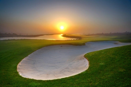 Couché de soleil sur le golf Royal Obidos au portugal